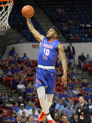 Louisiana Tech sophomore guard Dayon Griffin takes flight for a dunk in Saturday's win over UL Lafayette. Griffin netted a career-high 22 points.