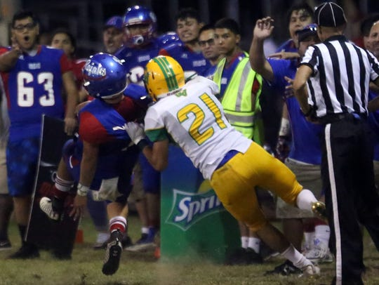 Indio quarterback Aubuchon Martinez is pulled down