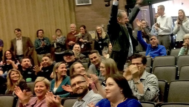 Kevin Gertig, executive director of Fort Collins Utilities, celebrates as Fort Collins employees learn the city has won the coveted Malcolm Baldrige Award for performance excellence.