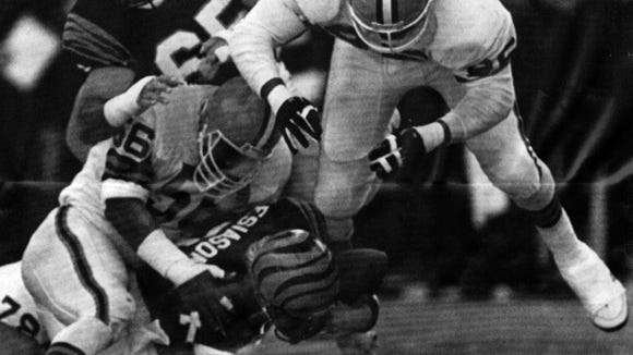 DECEMBER 14, 1986: Cincinnati Bengals quarterback Boomer Esiason is tackled for an 8-yard-loss by Cleveland Browns defenders Chip Banks, 56, and REggie Camp, right, during the second quarter of their NFL games at Riverfront Stadium Sunday afternoon.AP Photo/Al Behrmanscanned January 2, 2013