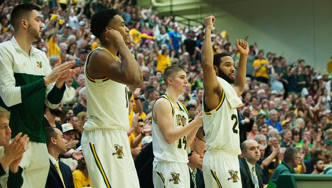 The Vermont bench cheers for the team during the men's basketball game between the Stony Brook Seawolves and the Vermont Catamounts at Patrick Gym on Saturday afternoon February 25, 2017 in Burlington.