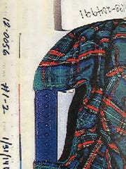 The green plaid baseball cap found at the scene of