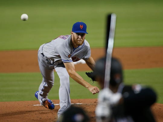 New York Mets' Zack Wheeler delivers a pitch during the first inning of a baseball game against the Miami Marlins, Friday, Aug. 10, 2018, in Miami. (AP Photo/Wilfredo Lee)