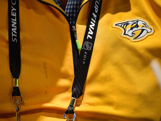 Nashville Predators owner Tom Cigarran wears a team sweater that he as not washed since the start of the Stanley Cup Playoffs and has the stains to prove it. Cigarran watches game 5 of the Stanley Cup Final against the Pittsburgh Penguins from his suite at PPG Paints Arena Thursday, June 8, 2017, in Pittsburgh, Pa.
