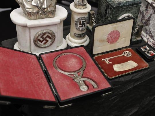 Artifacts bearing Nazi symbols that were recovered