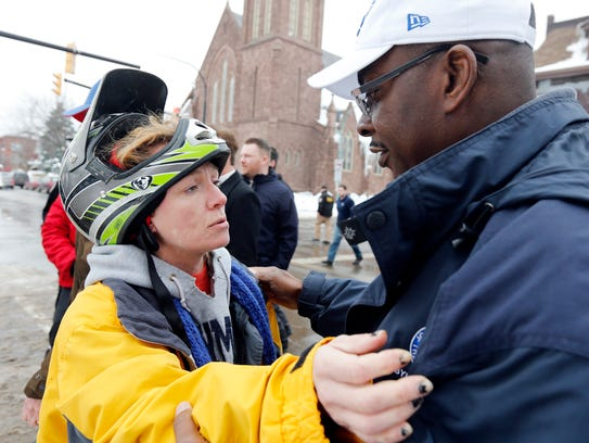 Nichole Kepple hugs Buffalo Mayor Byron Brown, thanking