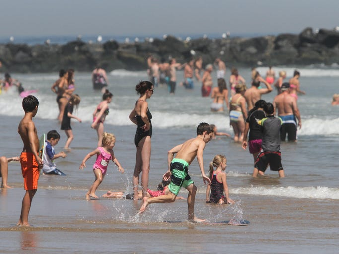 Belmar,  NJ       Beach goers hit the surf on the 9 Street beach in Belmar.  082514  Tom Spader/Asbury Park Press