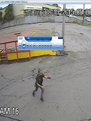 The suspect caught on camera with a gun.