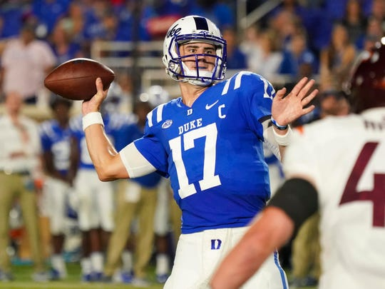 Sep 29, 2018; Durham, NC, USA;  Duke Blue Devils quarterback Daniel Jones (17) throws a first half touchdown pass against Virginia Tech Hokies at Wallace Wade Stadium. Mandatory Credit: James Guillory-USA TODAY Sports