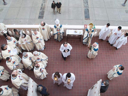 Catholic Church clergy members attend a late-afternoon
