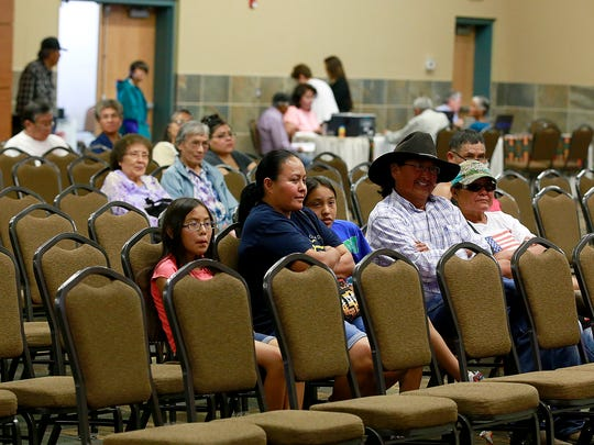 Crowd members interested in the Navajo Land Buy-Back Program listen to a speaker on Thursday during an information session at the Farmington Civic Center.