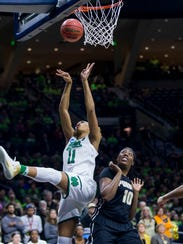 Notre Dame's Brianna Turner (11) goes up for a shot