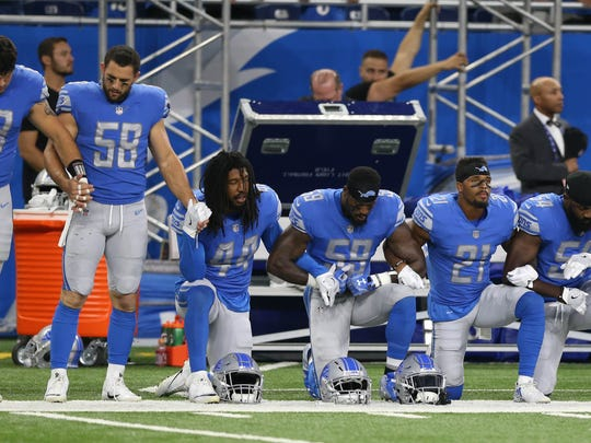 The Detroit Lions kneel and join arms in protest during the anthem before action against the Atlanta Falcons on  Sunday, September 24, 2017 at Ford Field in Detroit.