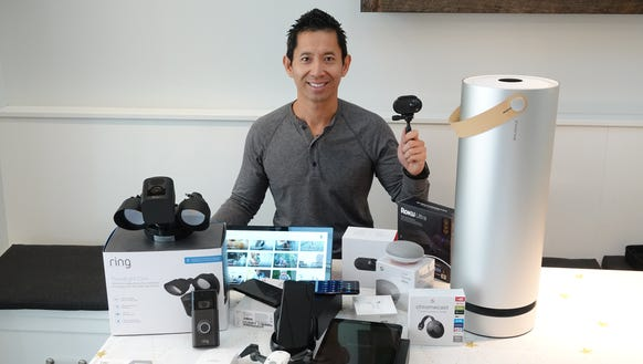 Tech investor Peter Pham surrounded by 15 of his favorite