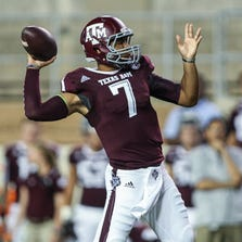 Sep 6, 2014; College Station, TX, USA; Texas A&M Aggies quarterback Kenny Hill (7) attempts a pass during the first quarter against the Lamar Cardinals at Kyle Field. Mandatory Credit: Troy Taormina-USA TODAY Sports