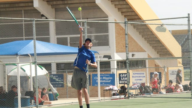Eighth grader Davis Dugan serves the ball during the District 3-6A Individual Tournament. Dugan advanced to the quarterfinals in boys singles mid-morning Friday.