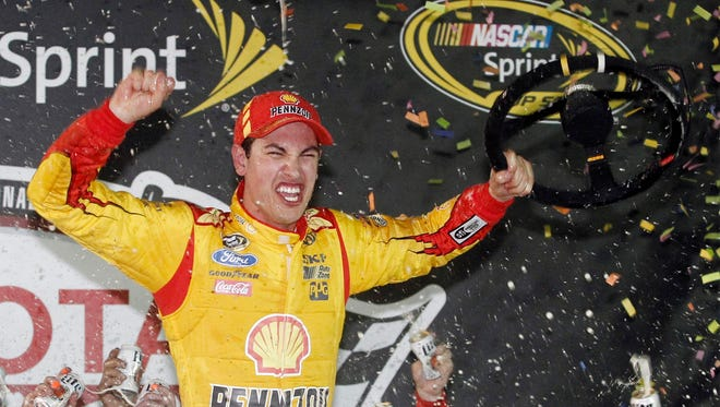 Sprint Cup driver Joey Logano (22) celebrates in victory lane after winning the Toyota Owners 400 at Richmond International Raceway.