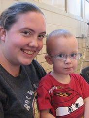 Jordan Applegate and son Kaiden, 2, attend programming