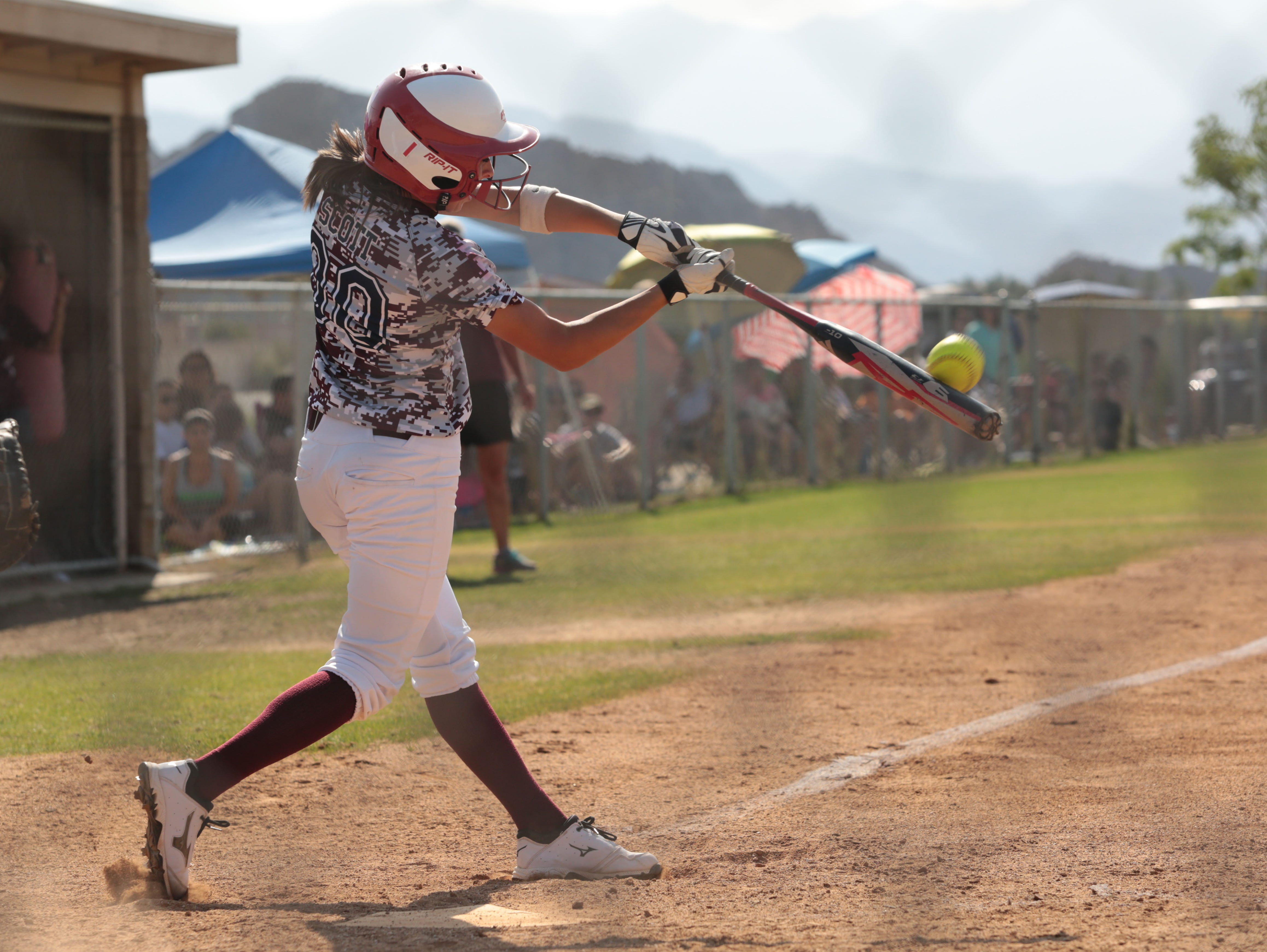 La Quinta's Kendyl Scott hits a home run in a high school game in this May 2014 file photo.