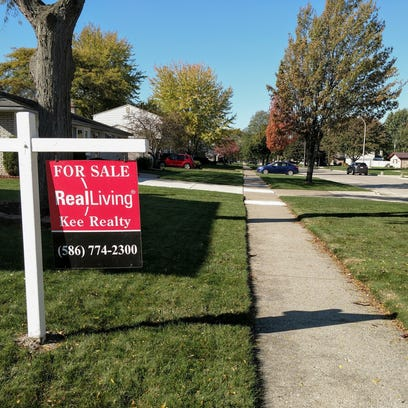 "A ""For Sale"" sign in front of a home on Lyndon in Livonia."