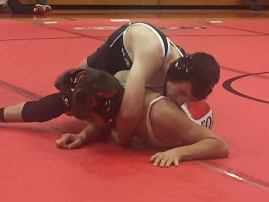 Madison's Adam Cook is on top of Loudonville's Daniel