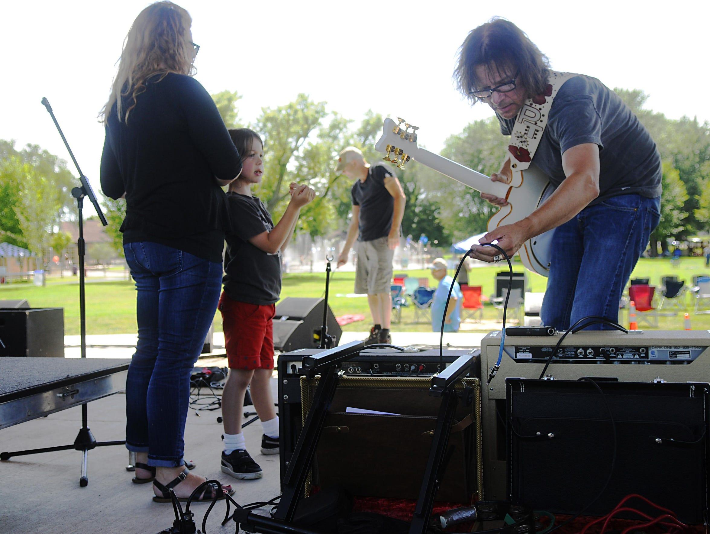 G.B. Leighton lead guitarist Patrik Tanner sets up