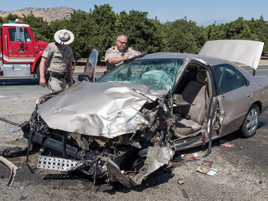 CHP officers investigate the collision of a truck and