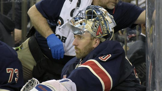 New York Rangers goaltender Henrik Lundqvist sits on