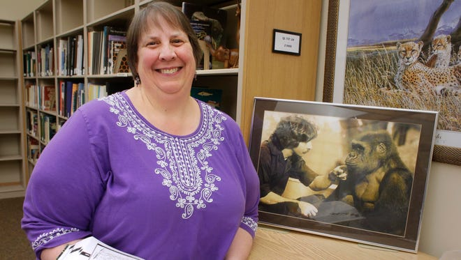 Mary Kazmierczak, the Milwaukee County Zoo librarian, reviews the collections at the zoo library. The library is mainly for research, but is open to the public.