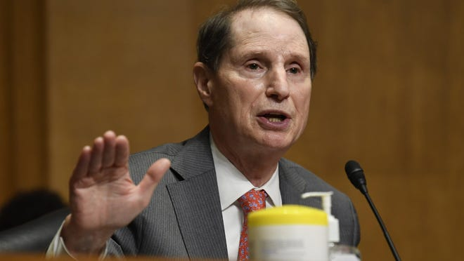 Sen. Ron Wyden, D-Ore., questions Internal Revenue Service Commissioner Charles Rettig at a Senate Finance Committee hearing on Capitol Hill in Washington, Tuesday, June 30, 2020, on the 2020 filing season and COVID-19 recovery.