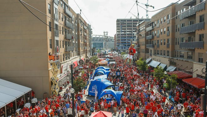 A sea of red packs Freedom Way as baseball fans enjoy themselves at the All-Star Block Party before the game Tuesday.