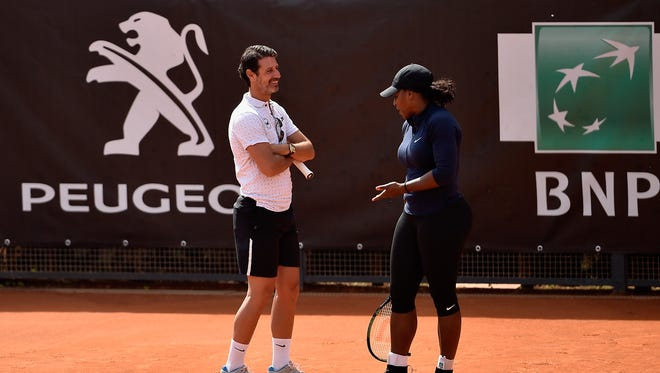 Serena Williams of the United States speaks to coach Patrick Mouratoglou during a training session at The Internazionali BNL d'Italia 2016 on May 8.