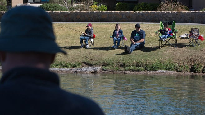 The New Mexico Department of Game and Fish along with the Mesilla Valley Flyfishers ran a kids fishing clinic, Saturday March 25, 2017 at the New Mexico State University Duck Pond. The kids and families that came to the event were invited to do some fishing, along with learning about types of fish and types of fishing equipment.
