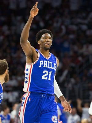 Sixers forward Joel Embiid reacts after the first basket of his NBA career on Wednesday night against the Thunder.