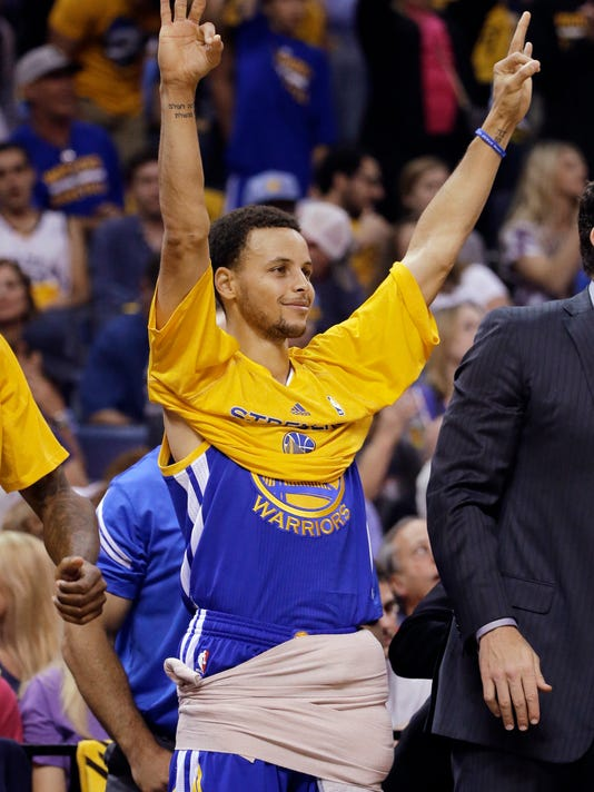 Golden State Warriors guard Stephen Curry gestures from the sidelines during the second half of Game 6 of a second-round NBA basketball Western Conference playoff series against the Memphis Grizzlies, Friday, May 15, 2015, in Memphis, Tenn. (AP Photo/Mark Humphrey)