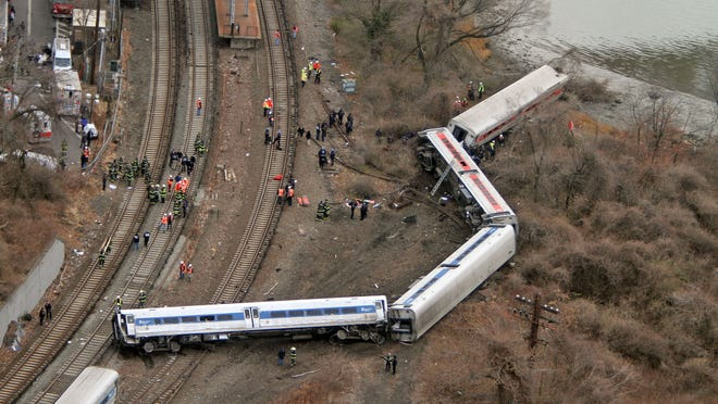 Emergency personnel work at the scene of a Metro-North train that derailed just north of the Spuyten Duyvil station in the Bronx borough of New York on  Dec. 1, 2013.