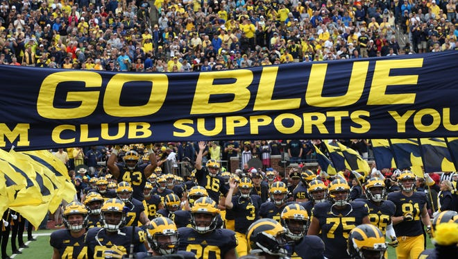Michigan runs onto the field before the start of the game against UNLV at Michigan Stadium on Saturday.