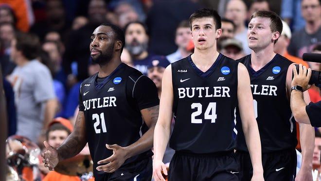 Butler Bulldogs guard Kellen Dunham (24), forward Roosevelt Jones (21) and forward Austin Etherington (0) look on after a play against the Virginia Cavaliers.