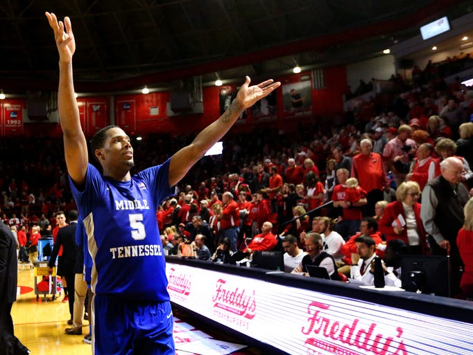 MTSU's Nick King (5) celebrates with the crowd after