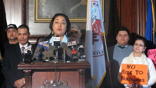 Menominee Tribe Vice Chair Crystal Chapman-Chevalier joins with union workers and a bipartisan group of state lawmakers to urge Gov. Scott Walker to reconsider his rejection of a Kenosha casino on Thursday in Madison.
