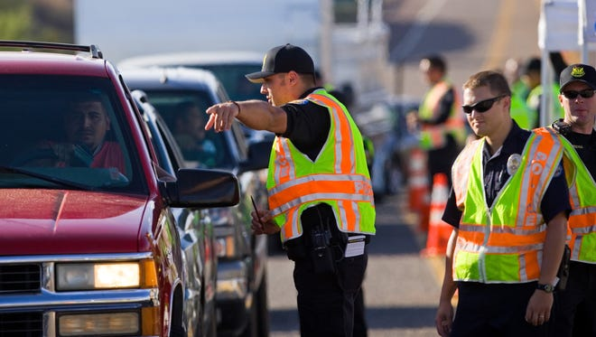 Phoenix police officer Dejan Nadzakovic talks with a motorist during a DUI checkpoint outside Lake Pleasant in Peoria.