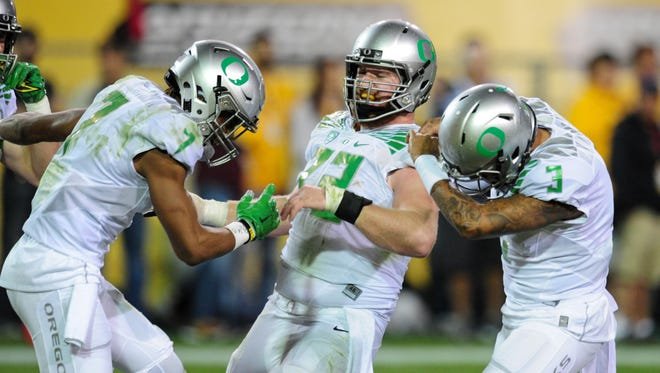 Oct 29, 2015; Tempe, AZ, USA; Oregon Ducks wide receiver Darren Carrington (7) celebrates with quarterback Vernon Adams Jr. (3) and offensive lineman Matt Hegarty (72) after scoring a 39 yard touchdown during the first half against the Arizona State Sun Devils at Sun Devil Stadium. Mandatory Credit: Matt Kartozian-USA TODAY Sports