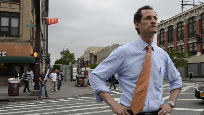 This file photo taken on May 23, 2013, shows former U.S. Representative Anthony Weiner as he greets voters and residents in the Harlem neighborhood of New York City.
