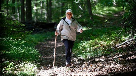 President of the Lebanon Valley Hiking Club, Sharon L. Southall, walks along Horseshoe Trail