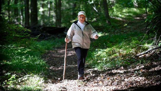 President of the Lebanon Valley Hiking Club, Sharon L. Southall, walks along Horseshoe Trail