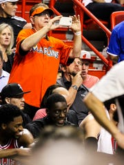 """Laurence Leavy, better known as """"Marlins Man"""" was at the Miami Heat vs Chicago Bulls game back in March. He is known for Tweeting and keeping up with social media during games."""