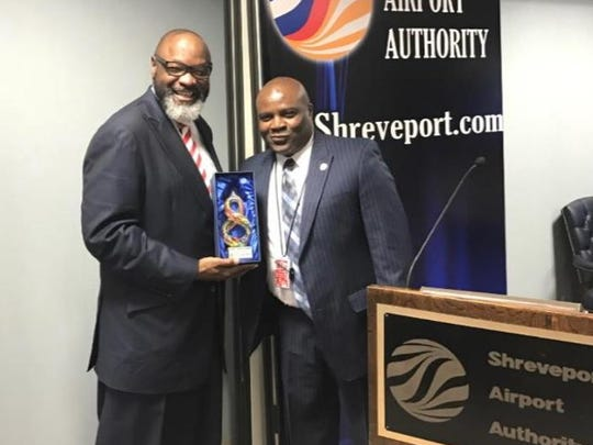 Bishop L. Lawrence Brandon with Henry Thompson, director Shreveport Airport Authority.