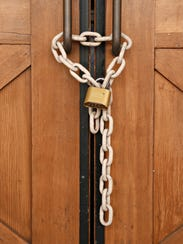 In this September 2015 photo, a chain and a lock secure
