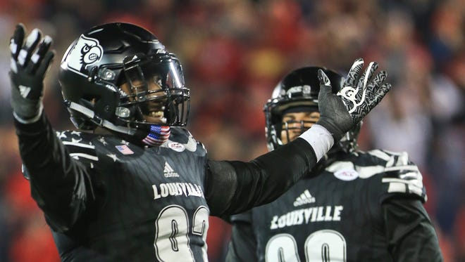 Louisville's Devonte Fields celebrates after sacking Wake Forest's John Wolford late in the fourth quarter as the Cardinals came back to win 44-12 over Wake Forest Saturday night at Papa John's Cardinal Stadium.
