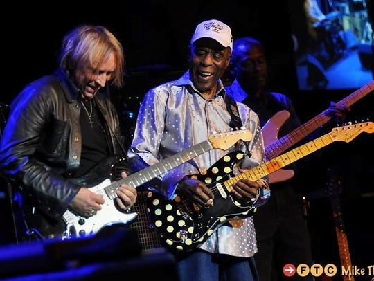 Paul Nelson performs with Buddy Guy in 2018.